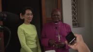 Archbishop Desmond Tutu said Tuesday he hoped to see a truly free Myanmar as he met fellow Nobel Peace Prize winner Aung San Suu Kyi during a visit...