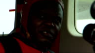Archbishop of York skydiving charity stunt preparations and interview More of Sentamu putting on protective headgear then boarding plane / Sentamu...