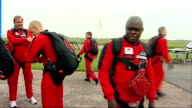 Archbishop of York skydiving charity stunt preparations and interview Sentamu questioned by reporters SOT Feeling on top of the world / Not nervous...