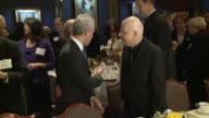 ArchbishopEmeritus Francis George and Mayor Rahm Emanuel talk before a breakfast at the Union League Club of Chicago on Nov 20 2014