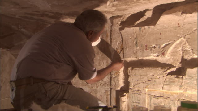 Archeologists work in an archeological dig in Egypt.