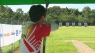 MS ZI Archer shooting an arrow at archery range / Seoul, South Korea