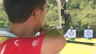 MS PAN Archer shooting an arrow at archery range / Seoul, South Korea