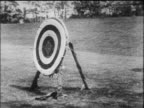 B/W 1916 archery target with arrows shooting into it / Wellesley College, MA