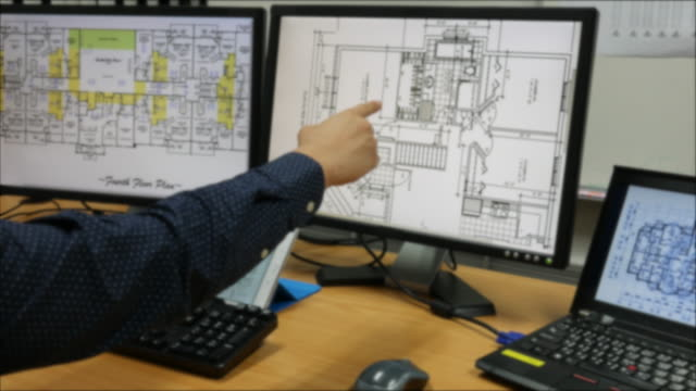 Architect at work with plan with computer