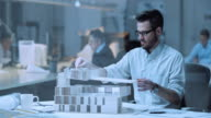 DS Architect constructing an architectural model in office