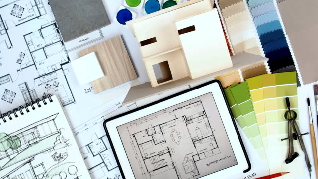 Architect Interior Designer Worktable With Home Model Tablet Blue Print Stock Footage Video