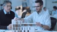 DS Architect presenting detailed solution to senior supervisor