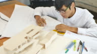 Architect putting a roof on his architectural model