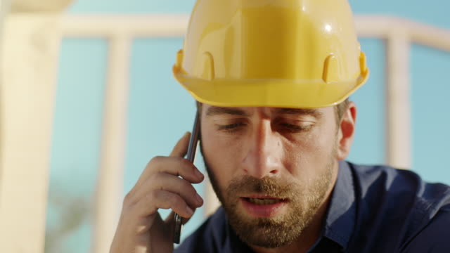 Architect talking on the phone at construction site