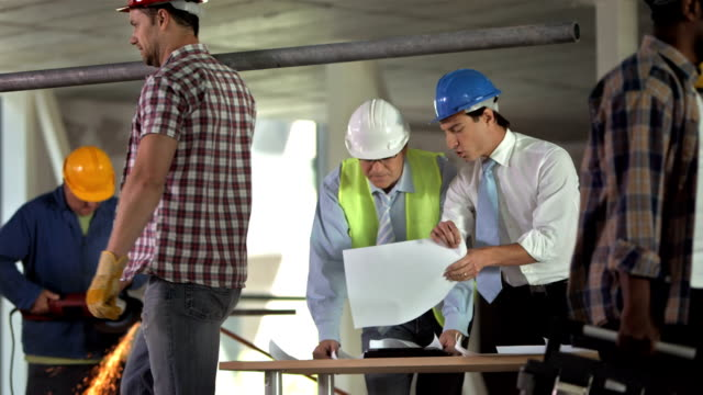 HD: Architect Talking With Construction Engineer
