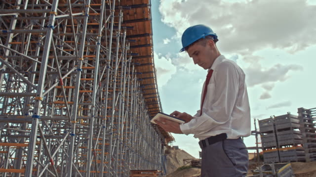 Architect using digital tablet at the construction site