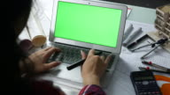 Architect using Laptop with green screen