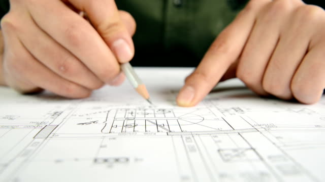 Architect Working on Blue Print