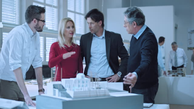 DS Architects going over the design with investing couple