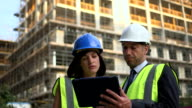 Architects on Construction site with digital tablet