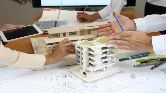 Architects Working Together the design solutions with Artificial model