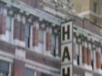 Architectural detail of Hahne amp CO over windows TD sign hanging from side of building HAHNES cars passing FG
