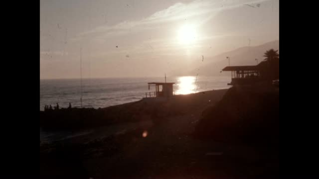 Archival film of a lifeguard tower in Southern California at sunset