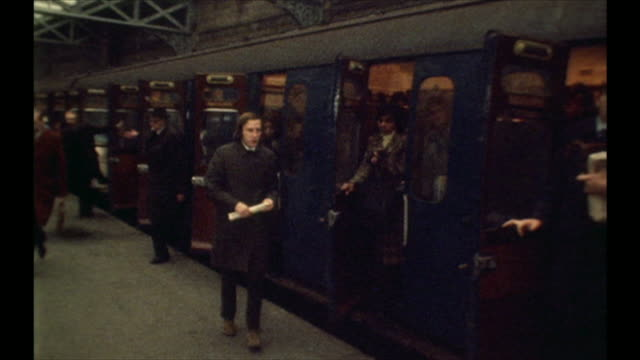 Archive footage of passengers disembarking a passenger train in the days of a nationalised railway run by British Rail