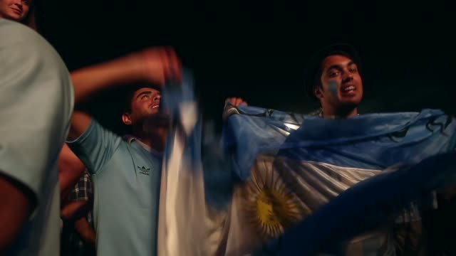LA MS Argentina fans celebrate a victory at the FIFA Fan Fest on Copacabanaa Beach on June 15 2014 in Rio de Janeiro Brazil The match was played on...