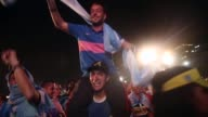 LS Argentina fans celebrate a victory at the FIFA Fan Fest on Copacabanaa Beach on June 15 2014 in Rio de Janeiro Brazil The match was played on the...