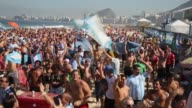 WS Argentina fans celebrate a victory at the FIFA Fan Fest on Copacabana Beach on June 25 2014 in Rio de Janeiro Brazil