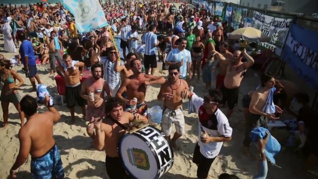 HA WS Argentina fans celebrate a victory at the FIFA Fan Fest on Copacabana Beach on June 25 2014 in Rio de Janeiro Brazil