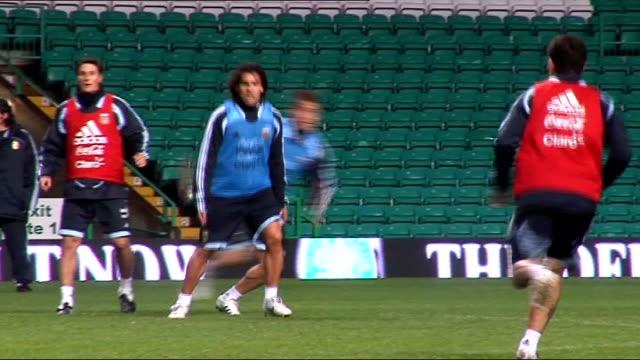 Argentina team training at Celtic Park Tevez during practice match / More of Maradona watching team / General view empty Celtic Park stadium interior...