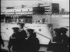 Argentinian troops marching in formation past several ships / pan of President Edelmiro Julian Farrell men in uniform saluting / prow of ship with...