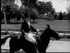 1924 B&W MS aristorcratic man riding horse/ man catching top hat as it falls off
