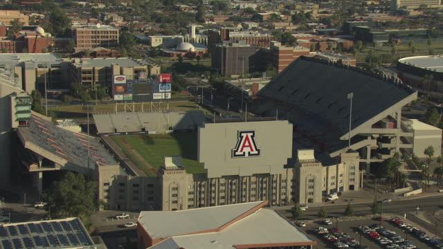 WS AERIAL Arizona Stadium football stadium with large A sign and University of Arizona at Tucson campus / Tucson, Arizona, United States