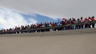 Arm in arm and holding flowers thousands of Mexicans formed a human wall on the border with the United States this Friday in protest against...