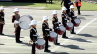 Armed Forces Day parade visited by David Cameron and Prince Edward **Music heard intermittently SOT** Air cadets drill then marching along / crowds...