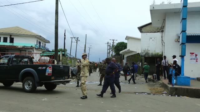 WS Armed Forces of Liberia attend to Shakie Kamara near the entrance to West Point A bullet from the melee apparently wounded his right leg after...
