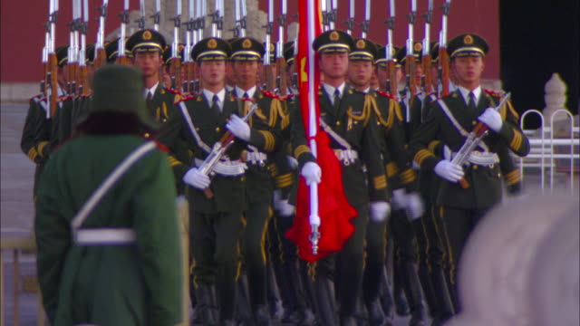 Armed guards march at the Forbidden City's North Gate.