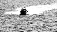 armed men on a speed boat