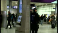 Armed police officers at St Pancras International following Paris attacks ENGLAND London St Pancras International Station INT Passengers along at...