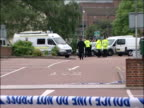 Armed police shoot woman dead in Kent ENGLAND Kent Sevenoaks Town Centre EXT Police officers forensics and police vehicles behind police cordon tape...
