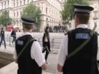 Armed policemen watch London streets