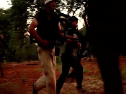 Armed rebels part of the Martyrs brigade train early in the morning in the Idlib province of Syria