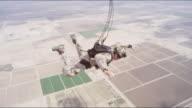 Armed Skydiver Deploys Parachute Over Desert