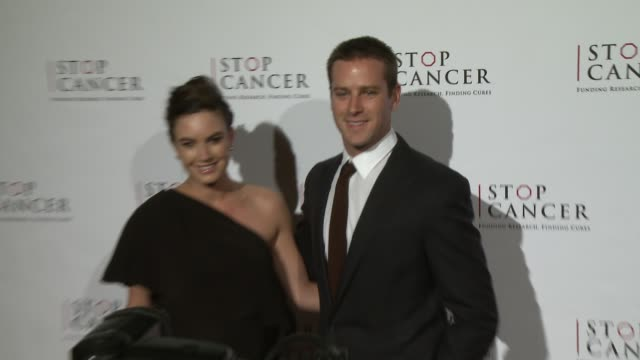 Armie Hammer and Elizabeth Chambers at Stop Cancer Annual Gala Honoring Lori And Michael Milken at The Beverly Hilton Hotel on November 23 2014 in...