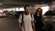 INTERVIEW Armie Hammer Elizabeth Chambers talk about who babysits their kid while arriving at LAX Airport in Los Angeles in Celebrity Sightings in...