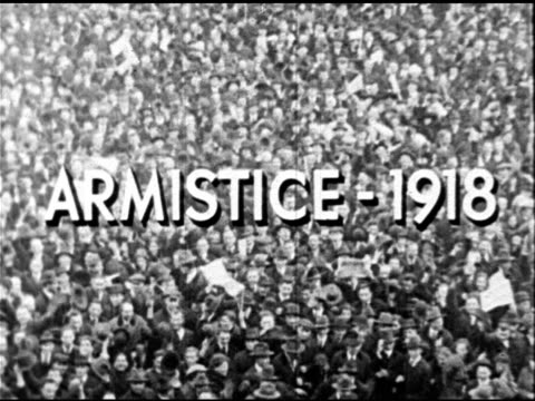 'Armistice 1918' superimposed over HA PAN of excited waving crowd in street World War I The Great War