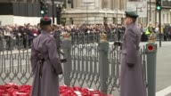 Armistice Day at the Cenotaph ENGLAND London Whitehall EXT Soldiers approach The Cenotaph / Closeups soldiers veterans and members of the public