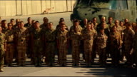 Armistice Day marked at Camp Bastion AFGHANISTAN Helmand Province Camp Bastion EXT British soldiers gathered as Last Post played SOT / British troops...