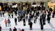 Armistice Day marked at Liverpool Street station Digital clock approaching 1100 am / high angle view of commuters observing two minute's silence on...