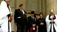 Armistice Day marked at St Paul's Cathedral Big Ben clock tower chiming and unseen buglar playing Last Post as veterans and clergy stand with heads...