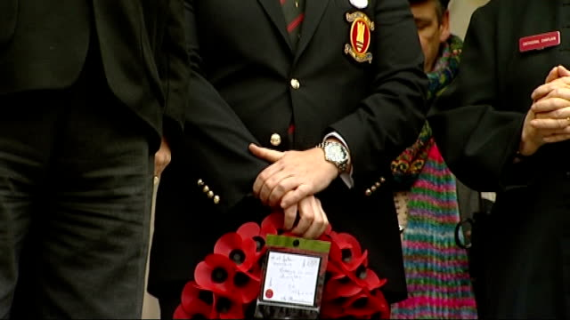 Armistice Day marked at St Paul's Cathedral Clergyman leading payers SOT / clergy and people reciting 'Our Father' prayer SOT / veteran holding...